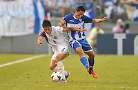Juan DIego Madrigal (6) of Costa RIca goes against Andy Najar (14) of Honduras.  Honduras defeated Costa Rica 1-0 at the quaterfinal game of the Concacaf Gold Cup, M&T Stadium, Sunday July 21 , 2013.