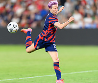 AUSTIN, TX - JUNE 16: Megan Rapinoe #15 of the United States passes the ball during a game between Nigeria and USWNT at Q2 Stadium on June 16, 2021 in Austin, Texas.