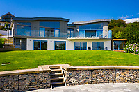 BNPS.co.uk (01202 558833)<br /> Pic: Rohrs&Rowe/BNPS<br /> <br /> Pictured: The house has a full width balcony running along the whole of the back of the house. <br /> <br /> An exceptional contemporary clifftop home with panoramic views of not one, but two beaches is on the market for offers over £2m.<br /> <br /> Seascape is a brand new home, completed earlier this year and never lived in, that has a frontline spot next to Porthpean Beach and Duporth Beach.<br /> <br /> The sleek four-bedroom home in the village of Porthpean, Cornwall, has incredible sea views from almost every room, a full width balcony and a gate in the garden straight onto the South West Coast Path.