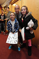 Pictured: Jazz Richards (C) with young supporters. Thursday 15 December 2011<br />