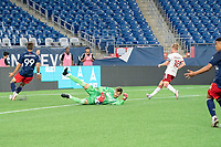 FOXBOROUGH, MA - JUNE 26: Colin Shutler #1 of North Texas SC saves a shot at goal during a game between North Texas SC and New England Revolution II at Gillette Stadium on June 26, 2021 in Foxborough, Massachusetts.
