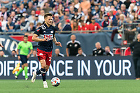FOXBOROUGH, MA - JULY 25: Arnor Traustason #25 of New England Revolution brings the ball forward during a game between CF Montreal and New England Revolution at Gillette Stadium on July 25, 2021 in Foxborough, Massachusetts.