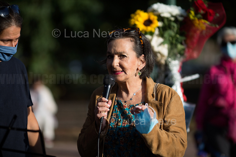 """Letizia Lopez (Sister of Maria Rosaria Lopez).<br /> <br /> Rome, 29/09/2020. Today, the VIII Municipio di Roma (8th Municipality of Rome) supported by the Associazione """"Il Tempo Ritrovato"""" and """"La Cultura Del Cuore"""", held a rally at Maria Rosaria Lopez's Park to commemorate the 45th anniversary of the Circeo massacre. On the 29th September 1975 Maria Rosaria Lopez and Donatella Colasanti were kidnapped, raped and tortured by three young-wealthy neo-fascist men, Angelo Izzo (20), Gianni Guido (19), Andrea Ghira (22), in a villa of Circeo, a wealthy seaside area about 100km south of Rome. Maria Rosaria Lopez (bartender, 19) was killed by her captors, Donatella Colasanti (student, 17), miraculously saved herself by pretending to be dead. From the organiser press released (1.): «[…] Maria Rosaria died that night, while Donatella left us in 2005 after years of struggles in the name of truth and justice trials which have traced a historical and cultural change in terms of condemnation of gender violence perpetrators and not of their victims. For the first time, feminist associations have taken civil action, shouting that for every woman raped and offended we are all women the victims of the violence […]».<br /> <br /> Footnotes & Links:<br /> 1. https://www.facebook.com/casaintdelledonneroma/photos/a.560595397299220/5070912089600839/?type=3&theater<br /> (Source, Globalist.it ITA) Un fiore per Rosaria e Donatella 45 anni dopo il massacro del Circeo http://bit.do/fJVuV<br /> (Source, Wikipedia.org, ITA) https://it.wikipedia.org/wiki/Massacro_del_Circeo"""