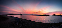 A panoramic view of sunset over the small boat lagoon at the San Leandro Marina Park along San Francisco Bay.