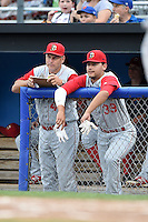 Brooklyn Cyclones hitting coach Benny Distefano (43) and outfielder Michael Conforto (39) in the dugout during a game against the Batavia Muckdogs on August 11, 2014 at Dwyer Stadium in Batavia, New York.  Batavia defeated Brooklyn 4-3.  (Mike Janes/Four Seam Images)