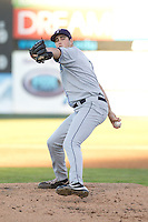 Ryan Warner #7 of the Tri-City Dust Devils delivers a pitch during a game against the Everett AquaSox at Everett Memorial Stadium in Everett, Washington on July 28, 2014. Tri-City defeated Everett 6-5 in 11 innings.  (Ronnie Allen/Four Seam Images)