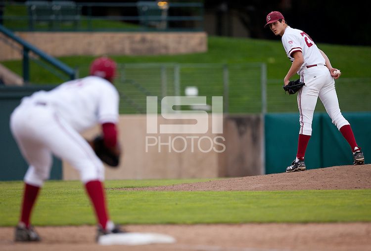 STANFORD, CA - March 25, 2011: Mark Appel of Stanford baseball looks to first during Stanford's game against Long Beach State at Sunken Diamond. Stanford lost 6-3.