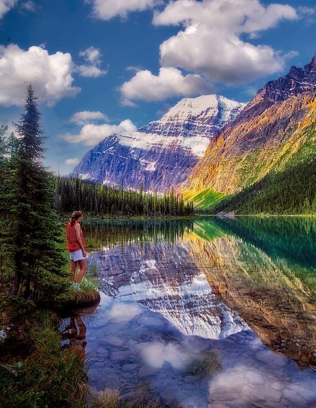 Young girl, Cavell Lake and Mount Edith Cavell. Jasper National Park, Canada.
