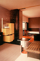 Gerrit Rietveld: Schroder House. Looking from living/dining area--note speaking tube, left, to kitchen on ground floor and stacking cabinet. To boy's room, rear. In the foreground, the end table.