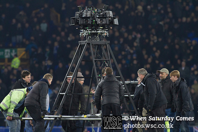 Everton 0 West Bromwich Albion 0, 19/01/2015. Goodison Park, Premier League. A giant panoramic camera being lifted into place on the pitch at half-time for filming of a Hollywood film at Goodison Park, Liverpool during the Premier League match between Everton and West Bromwich Albion. The match ended in a 0-0 draw, despite the home team missing a first-half penalty by Kevin Mirallas. The game was watched by 34,739 spectators and left both teams languishing near the relegation zone. Photo by Colin McPherson.