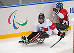 Sochi, RUSSIA - Mar 11 2014 -  Derek Whitson contras the puck Canada takes on Czech Republic in Sledge Hockey at the 2014 Paralympic Winter Games in Sochi, Russia.  (Photo: Matthew Murnaghan/Canadian Paralympic Committee)