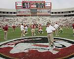 Florida State University head coach Bobby Bowden (C) walks across the Seminole logo at mid-field as he watches the Wake Forest Demon Deacons warm up prior to the game between the two teams at Bobby Bowden Field October 8, 2005 in Tallahassee, Florida.   (Mark Wallheiser/TallahasseeStock.com)