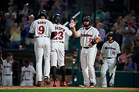 Rochester Red Wings Wilin Rosario (20) high fives Jordany Valdespin (23) and Jaylin Davis (9) after a home run by Davis during an International League game against the Scranton/Wilkes-Barre RailRiders on June 24, 2019 at Frontier Field in Rochester, New York.  Rochester defeated Scranton 8-6.  (Mike Janes/Four Seam Images)