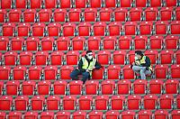 17th May 2020,Stadion An der Alten Försterei, Berlin, Germany; Bundesliga football, FC Union Berlin versus Bayern Munich;  Stewards wearing masks in the stands discuss the play