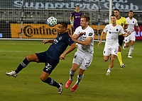 KANSAS CITY, KS - OCTOBER 07: #22 Winston Reid of Sporting Kansas City and #27 Robert Beric of Chicago Fire FC battle for the ball during a game between Chicago Fire and Sporting Kansas City at Children's Mercy Park on October 07, 2020 in Kansas City, Kansas.