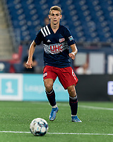 FOXBOROUGH, MA - JULY 23: Noel Buck #61 of New Englans Revolution II passes the ball during a game between Toronto FC II and New England Revolution II at Gillette Stadium on July 23, 2021 in Foxborough, Massachusetts.