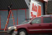 Pete Nielsen of Springfield, Mo., replaces a light bulb Wednesday, Jan. 6, 2021, while working at the AutoZone Auto Parts location at College Avenue and Lafayette Street in Fayetteville. Nielsen makes repairs and maintains about 50 AutoZone locations across the region. Visit nwaonline.com/210107Daily/ for today's photo gallery. <br /> (NWA Democrat-Gazette/Andy Shupe)