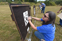 Angie Reynolds of Russellville adds up her score Sept. 24 2021 after shooting her muzzle-loading rifle. <br />(NWA Democrat-Gazette/Flip Putthoff)