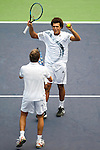 SHANGHAI, CHINA - OCTOBER 18:  Jo-Wilfried Tsonga and Julien Benneteau of France celebrate match point to Mariusz Fyrstenberg and Marcin Matkowski of Poland on their doubles final during day eight of 2009 Shanghai ATP Masters 1000 at Qi Zhong Tennis Centre on October 18, 2009 in Shanghai, China. Photo by Victor Fraile / The Power of Sport Images