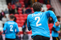 Bradford City players warm up in tops with Stephen Darbys name on them who earlier in the week announced his retirement from football due to been diagnosed with Motor Neurone Disease before  the Sky Bet League 1 match between Doncaster Rovers and Bradford City at the Keepmoat Stadium, Doncaster, England on 22 September 2018. Photo by Thomas Gadd.