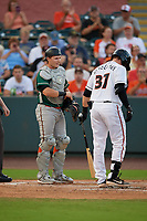 Greensboro Grasshoppers catcher Grant Koch (34) talks with batter Adley Rutschman (37) during a South Atlantic League game against the Delmarva Shorebirds on August 21, 2019 at Arthur W. Perdue Stadium in Salisbury, Maryland.  Delmarva defeated Greensboro 1-0.  (Mike Janes/Four Seam Images)