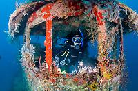 Diver Sara Brookes exploring the wreck of the M/V Corinthian, a tugboat, St. Kitts, Caribbean.
