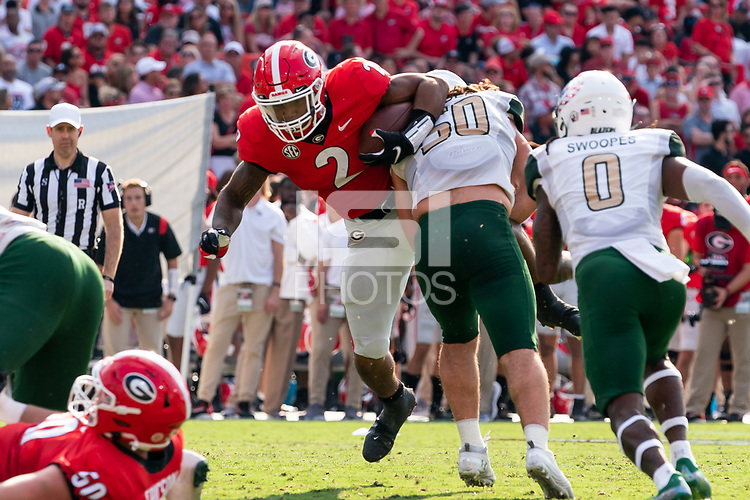 ATHENS, GA - SEPTEMBER 11: Kendall Milton #2 is tackled in the backfield by Noah Wilder #50 during a game between University of Alabama Birmingham Blazers and University of Georgia Bulldogs at Sanford Stadium on September 11, 2021 in Athens, Georgia.