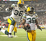 Green Bay Packers cornerback Tramon Wiliams (38) runs into the end zone with an interception return for a touchdown against the Atlanta Falcons during the second quarter of the Divisional round playoff game at the Georgia Dome in Atlanta, Ga., on Saturday, Jan. 15, 2011.  Safety Nick Collins (36) jumps into the air to celebrate with Williams.