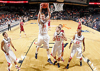 Nov 6, 2010; Charlottesville, VA, USA; Virginia Cavaliers f James Johnson (34) grabs a rebound Saturday afternoon in exhibition action at John Paul Jones Arena. The Virginia men's basketball team recorded an 82-50 victory over Roanoke College.