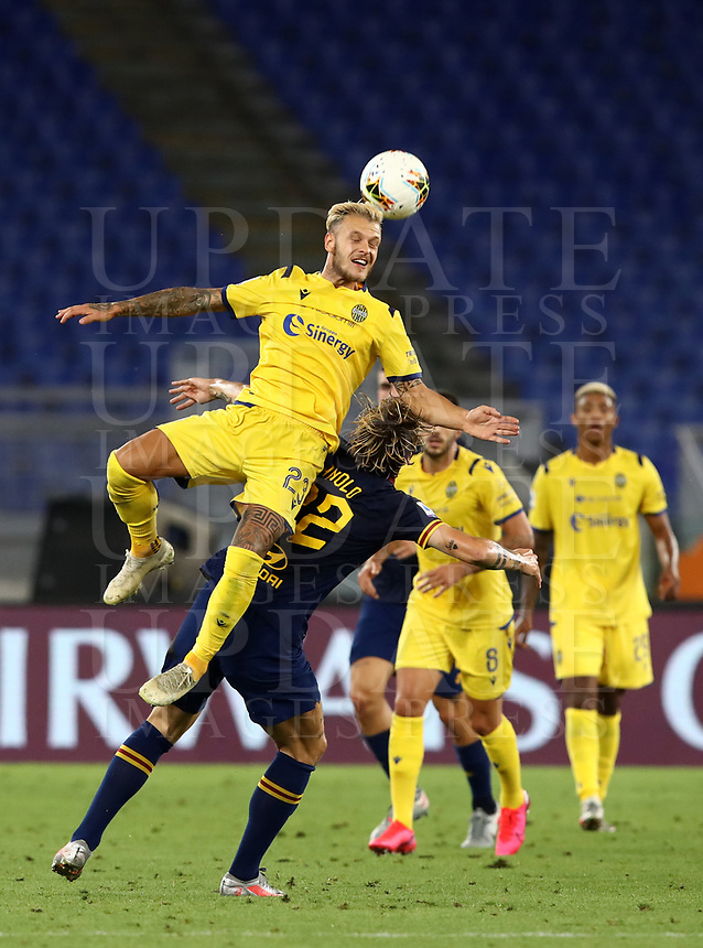 Football, Serie A: AS Roma - Hellas Verona Fc, Olympic stadium, Rome, July 15, 2020. <br /> Verona's Federico Di Marco (l) in action with Roma's Nicolò Zaniolo (r) during the Italian Serie A football match between Roma and Hellas Verona at Rome's Olympic stadium, on July 15, 2020. <br /> UPDATE IMAGES PRESS/Isabella Bonotto