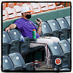 Head coach Monte Lee of the Clemson Tigers watces a scrimmage at Doug Kingsmore Stadium in Clemson, South Carolina.  (Tom Priddy/Four Seam Images)