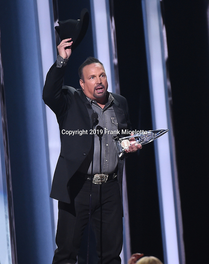 NASHVILLE, TN - NOVEMBER 13: Garth Brooks accepts the award for Entertainer of the Year on the 53rd Annual CMA Awards at the Bridgestone Arena on November 13, 2019 in Nashville, Tennessee. (Photo by Frank Micelotta/PictureGroup)