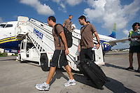 Landon Donovan and Clint Dempsey get off the  plane as the USA arrives in  Cuba, Thursday, Sept. 4, 2008.