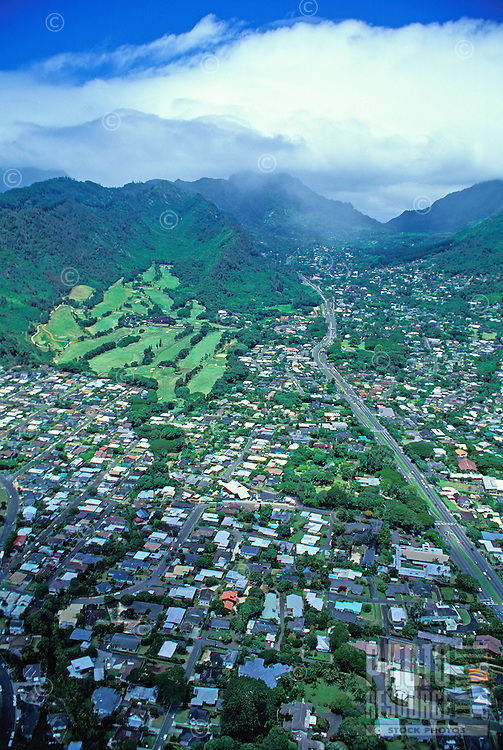 Stunning aerial shot the lush golf course at Oahu Country Club in Nuuanu, nestled at the foot of the striking green Koolau mountains and a world away from the nearby Pali Highway and populous homes of Honolulu.