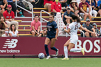 NEWTON, MA - AUGUST 29: Jaydah Bedoya #13 of University of Connecticut brings the ball forward during a game between University of Connecticut and Boston College at Newton Campus Soccer Field on August 29, 2021 in Newton, Massachusetts.