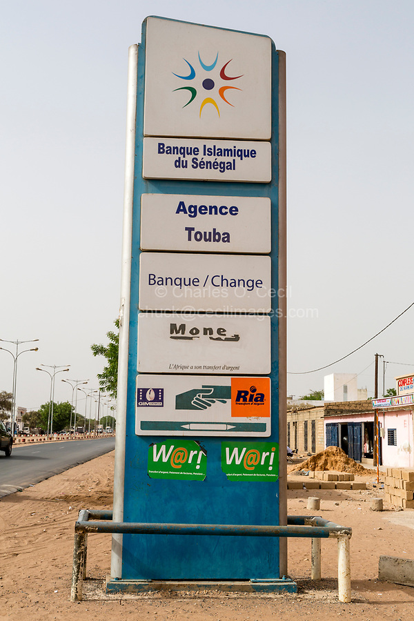 Senegal, Touba.  Advertising Panels for Islamic Bank of Senegal and other Money Transfer Services.