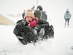 Aine Donegan and Aimee Marron having fun in the snow at Woodstock View in Ennis. Photograph by John Kelly.