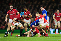 Gregory Alldritt of France is tackled by Tomos Williams of Wales during the Guinness Six Nations Championship Round 3 match between Wales and France at the Principality Stadium in Cardiff, Wales, UK. Saturday 22 February 2020