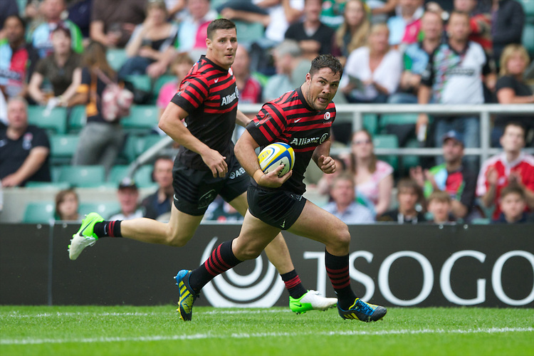 Brad Barritt of Saracens runs in a try during the Aviva Premiership match between Saracens and London Irish at Twickenham on Saturday 1st September 2012 (Photo by Rob Munro)