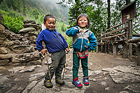 Mountain kids photographed outside their home in a little hamlet between Lukla and Monjo, Khumbu, Nepal