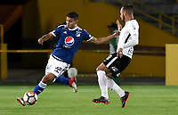 BOGOTA - COLOMBIA – 28 - 02 - 2018: Jhon Duque (Izq.) jugador de Millonarios (COL), disputan el balon con Maycon (Der.) jugador de Corinthians (BRA), durante partido entre Millonarios (COL) y Corinthians (BRA), de la fase de grupos, grupo 7, fecha 1 de la Copa Conmebol Libertadores 2018, en el estadio Nemesio Camacho El Campin, de la ciudad de Bogota. / Jhon Duque (L) player of Millonarios (COL), fights for the ball with Maycon (R) player of Corinthians (BRA), during a match between Millonarios (COL) and Corinthians (BRA), of the group stage, group 7, 1st date for the Conmebol Copa Libertadores 2018 in the Nemesio Camacho El Campin stadium in Bogota city. VizzorImage / Luis Ramirez / Staff.