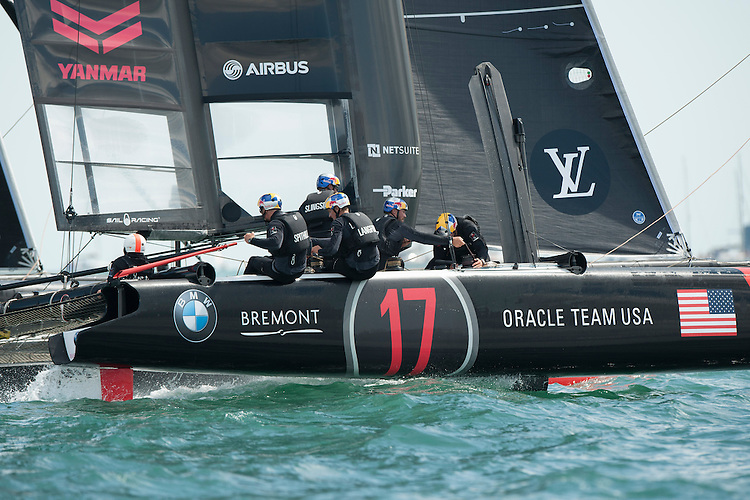 25 July 2015: Oracle Team USA in action during the America's Cup first round racing off Portsmouth, England (Photo by Rob Munro)
