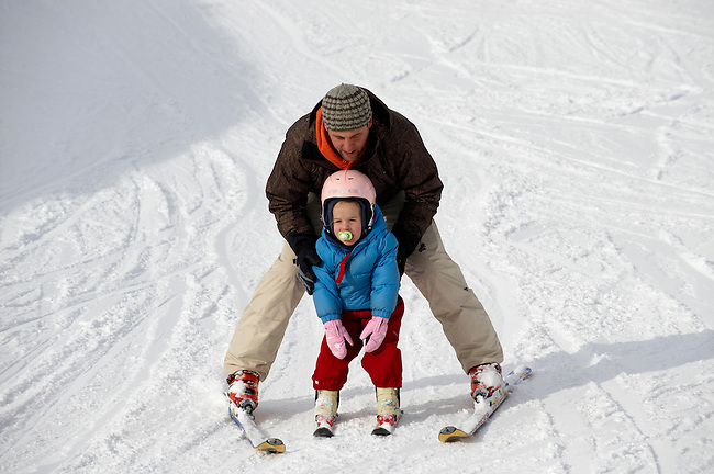 Father teaching his  child to Ski- Insbruck - Austrian Tyrol