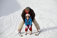 Father teaching his  child to Ski- Insbruck - Austrian Tyrol