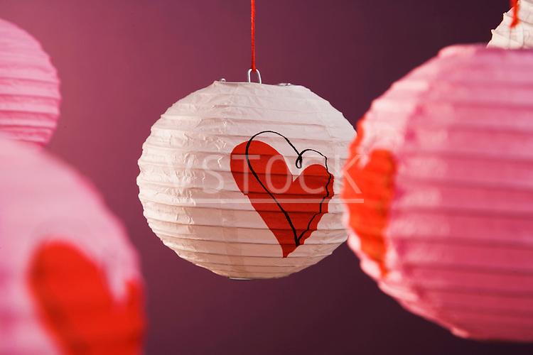 Paper lanterns on pink background