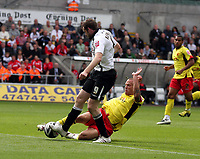 ATTENTION SPORTS PICTURE DESK<br /> Pictured: Craig Beattie of Swansea (L) tackled by Jay DeMerit of Watford (R) on the line of Watford's box.<br /> Re: Coca Cola Championship Swansea City Football Club v Watford at the Liberty Stadium, Swansea, south Wales. Saturday 29 August 2009<br /> Picture by D Legakis Photography / Athena Picture Agency, 24 Belgrave Court, Swansea, SA1 4PY, 07815441513