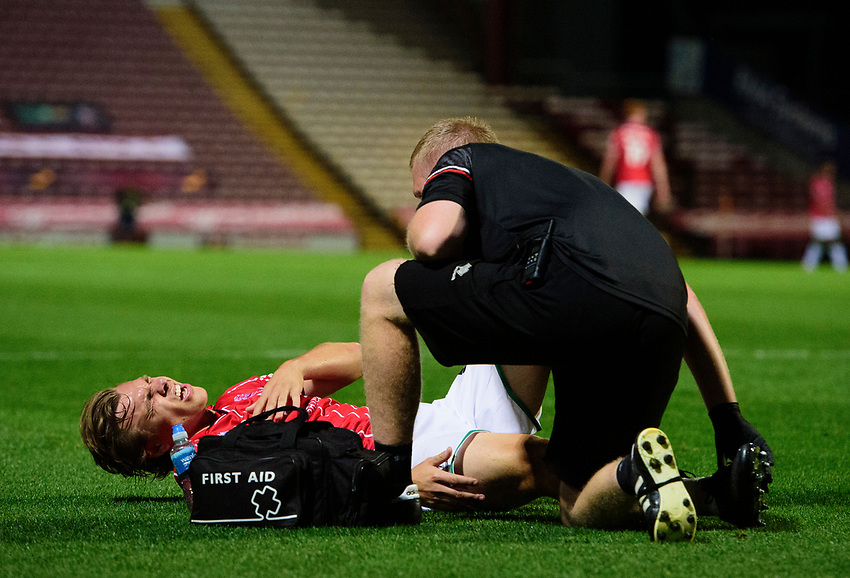 Lincoln City's Harry Anderson receives treatment  from Lincoln City sports science and medicine assistant Luke Treadwell<br /> <br /> Photographer Chris Vaughan/CameraSport<br /> <br /> Carabao Cup Second Round Northern Section - Bradford City v Lincoln City - Tuesday 15th September 2020 - Valley Parade - Bradford<br />  <br /> World Copyright © 2020 CameraSport. All rights reserved. 43 Linden Ave. Countesthorpe. Leicester. England. LE8 5PG - Tel: +44 (0) 116 277 4147 - admin@camerasport.com - www.camerasport.com