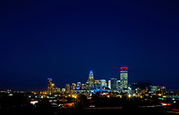 Skyline photography of the Charlotte NC downtown skyline. Photo, taken from the west side of Charlotte, is part on a regularly updated collection of Charlotte skyline imagery. Image shows the Duke Energy headquarters tower (far left) and the Bank of America tower (center) as well as other key structures in the Charlotte NC skyline.<br /> <br /> Charlotte Photographer - PatrickSchneiderPhoto.com