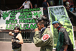 """Mexican youths walk past a banner that reads """"Marijuana is Life, Don't forbid marijuana. Legalize it"""" prior to a rally where hundreds of youths demanded to legalize marijuana during a rally in Mexico city, May 3, 2008.  Photo by Heriberto Rodriguez"""