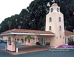 """A rare early-postwar example of Spanish Revival design, this Millbrae, California motel stands on land originally granted to the Valencia family by the Spanish government.  The site was purchased from the Valencias by Martin Wilms and his son Earl in 1947, and the original 36-unit motel opened in 1949.  The building used familiar Spanish Revival cues such as the tower, arch, and barrel tile roof, although much simplified from their prewar form.  According to the present owner, the grandson of Martin Wilms, the building's architecture """"seems to always have been in style, and will always be in style.""""  Although the motel has since been enlarged to include 306 units and a restaurant, the owners have sought to maintain the flavor of the original in their additions."""